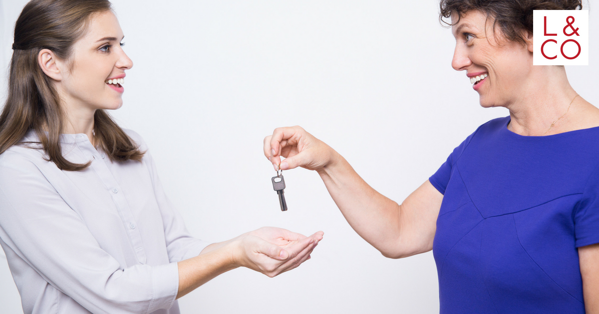 mother giving house keys to daughter